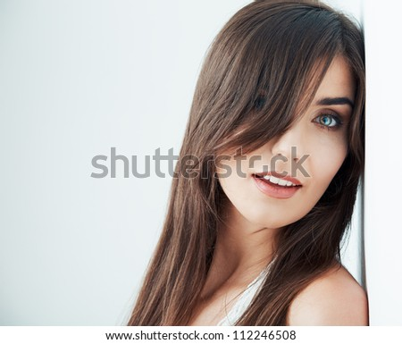 Woman hair style fashion portrait. close up female face.