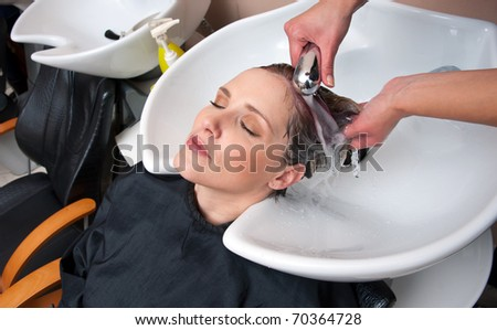 woman hair washed in salon pool - stock photo