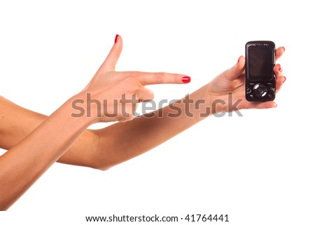 Woman hand and mobile phone. Isolated on white. - stock photo