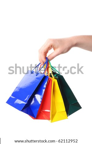 woman hand carrying a bunch of colored shopping bags isolated on white