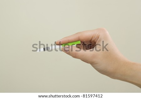 Woman hand hold pregnancy test with negative result