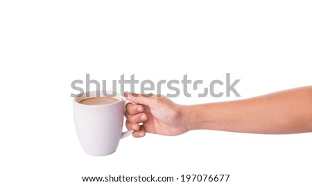 Woman hand holding a mug of coffee with creamer over white background