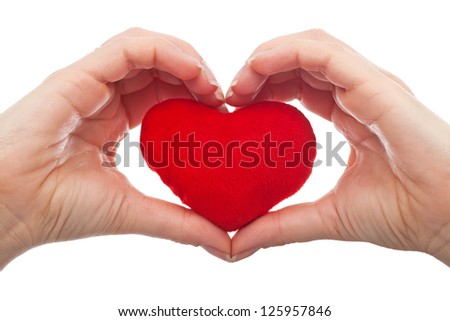 Woman hand holding a red heart - love concept