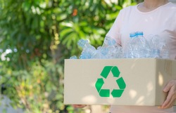 Woman hand holding box of garbage for recycle, Plastic bottles garbage for recycling concept reuse. Recycle or World Environment Day concept.