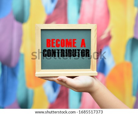 Woman hand holding chalkboard written BECOME A CONTRIBUTOR. Stock photo ©