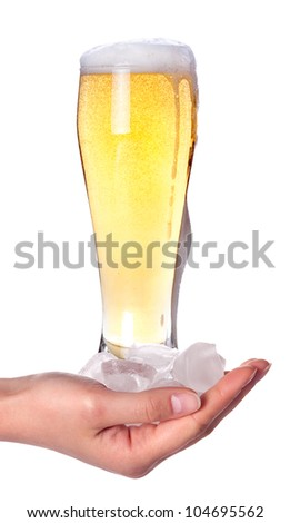 Woman hand holding fresh beer with ice cubes on a white