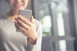 Woman hand holding mobile phone, She using in mobile applications and multimedia programs. copy space