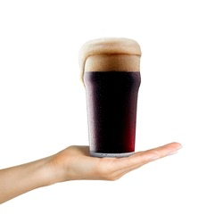 Woman hand holding mug of beer with foam on white background. Isolated with clipping path.