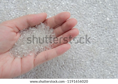 Woman hand holding Pet polyester chips,Plastic pet polyester chips,Chips bright