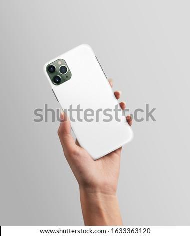 Woman hand holding Phone with plastic case mockup ストックフォト ©