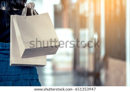 woman hand holding shopping...