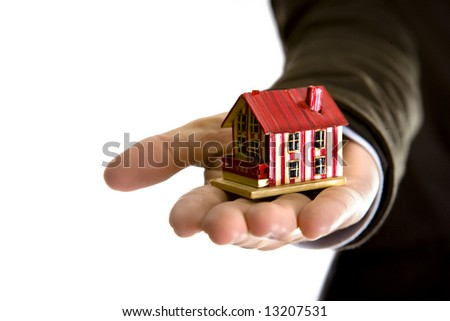 woman hand holding small house - real state concept