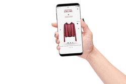 Woman hand holding smartphone and shopping online isolated on white background background. Online shopping concept
