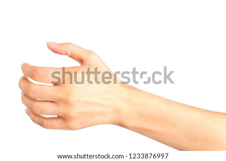 Woman hand holding something like a bottle or glass. Isolated with clipping path.