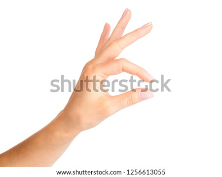Woman hand holding something little with two fingers. Isolated with clipping path. #1256613055