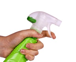 Woman hand holding spray bottle