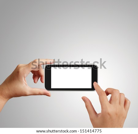 woman hand holding the phone tablet touch computer gadget as concept