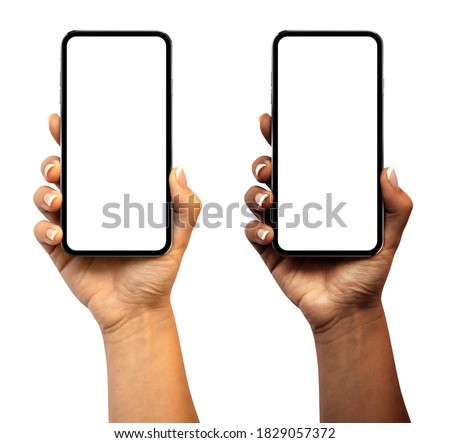 Woman hand holding the smartphone with blank screen and modern frameless design (black and white skinned version) - isolated on white background