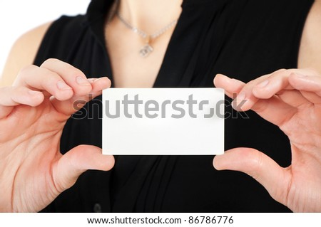 Woman hand holding white empty blank business card, shallow DOF