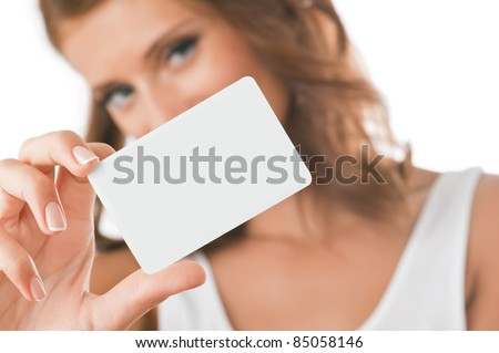 Woman hand holding white empty blank business card, shallow DOF, face in blur