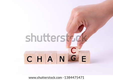 woman hand holding wooden cube with flip over block CHANGE to CHANCE word on withe table background. success, strategy, solution, business and Positive thinking concepts with space for advertisers. #1384475471