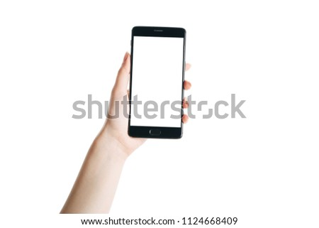 woman hand holds smartphone isolated on white background, with a clean screen #1124668409