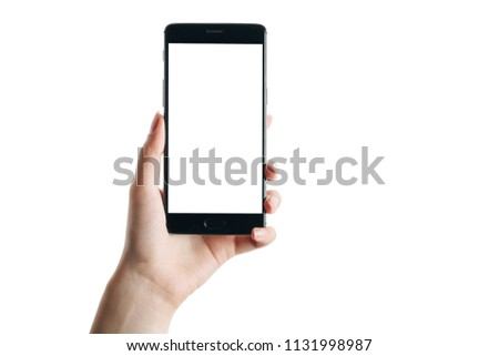 woman hand holds smartphone isolated on white background, with a clean screen #1131998987