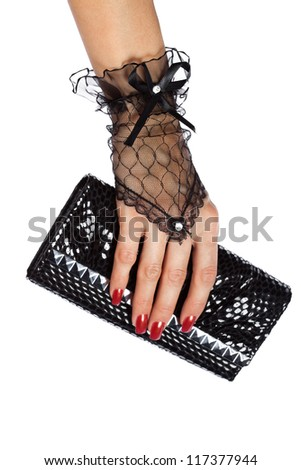 woman hand in black lace gloves with purse