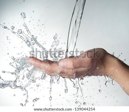 woman hand in water splash