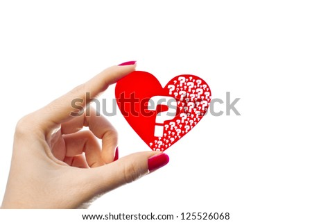 Woman hand is holding red heart shape with question marks inside of it isolated on white/Heart questions
