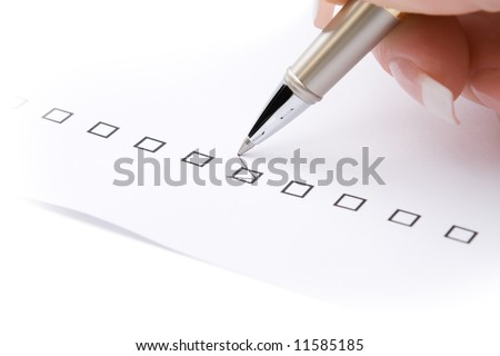 Woman hand marking a check box