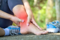 woman hand massaging her leg pain because of twisted ankle broken from exercise