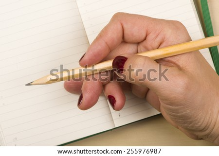 Woman hand notebook with pencil  details draw