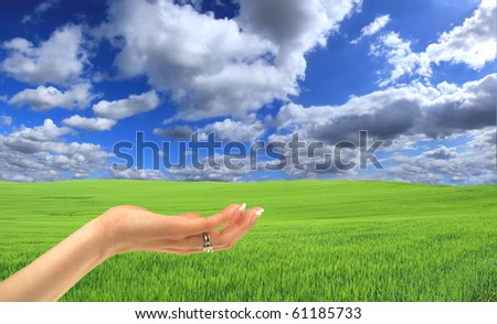 Stock Photo Woman hand offering new location