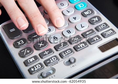 Woman hand on a digital calculator