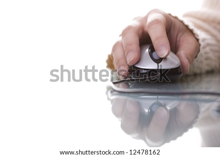 Woman hand on a mouse isolated on white with reflection and copy space (selective ans soft focus)