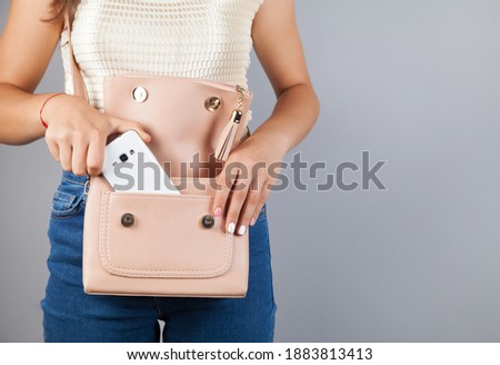 Woman hand phone on bag pocket. Stock foto ©