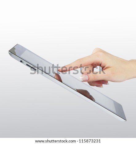 woman hand point on modern electronic digital frame with blank screen