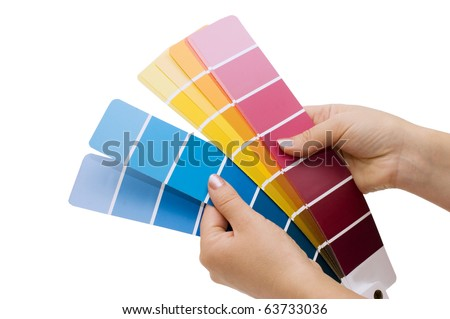 Woman hand pointing to a sample color chart