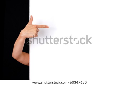woman hand pointing to white wall