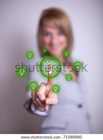 woman hand pressing light bulp icon