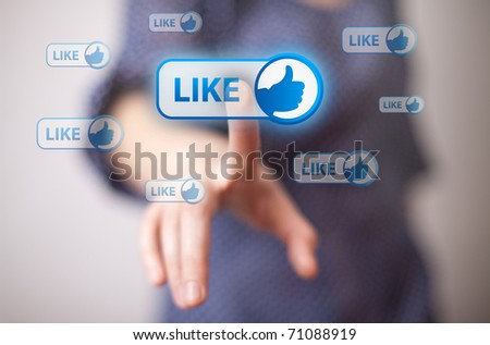 woman hand pressing Like button
