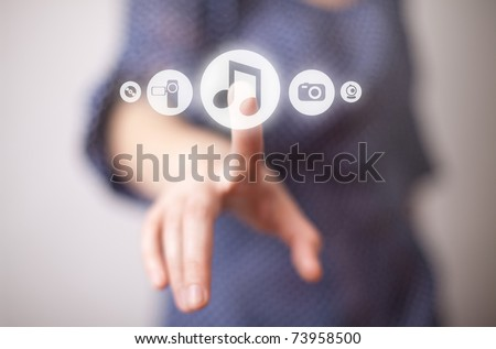 woman hand pressing Play button
