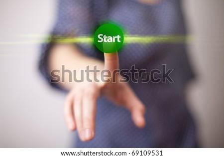 woman hand pressing START button - stock photo