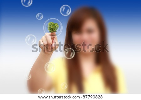 woman hand pressing tree bubble