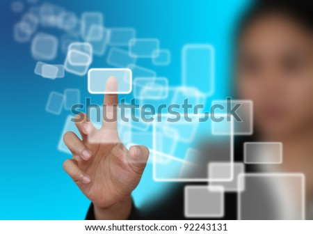 woman hand push on technology virtual touch screen interface (selective focus at finger)