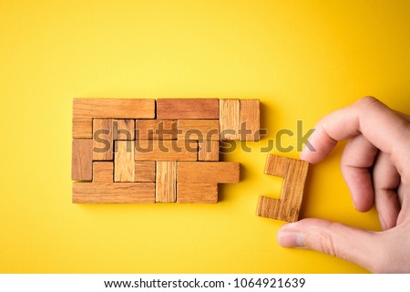 woman hand put wooden blocks arranging stacking for finishing task. Concept of solve problem and success plan