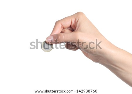 Woman hand putting an euro coin isolated on a white background