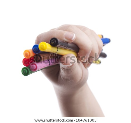 Woman hand's holding colorful pens