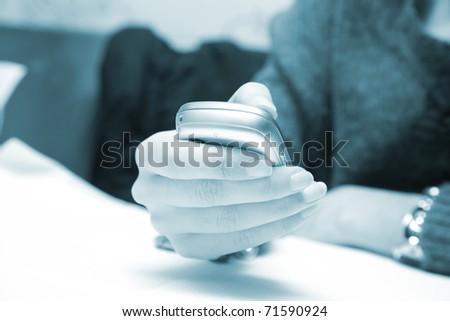 Woman hand sending an sms